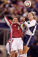 "Katrine Pedersen of Denmark goes up for a header against the USA's Abby Wambach. The US Women's National Team tied the Denmark Women's National Team 1 to 1 during game 8 of the 10 game the ""Fan Celebration Tour"" at Giant's Stadium, East Rutherford, NJ, on Wednesday, November 3, 2004.."