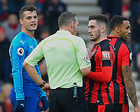 Referee Kevin Friend  has words with Lewis Cook of AFC Bournemouth as Granit Xhaka of Arsenal left looks on during AFC Bournemouth vs Arsenal, Premier League Football at the Vitality Stadium on 14th January 2018