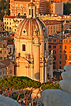 Looking down at the streets around the Altare della Patria at sunset; view of the 16th century churches Chiesa SS nome di Maria