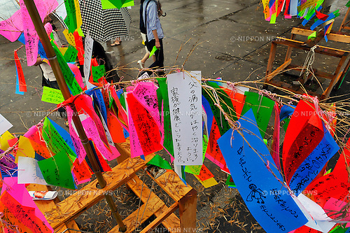 July 7th, 2012 : Tokyo, Japan -  Wishes were strung on bamboos as a custom of Tanabata Festival, a traditional festival on July 7 every year, at Zojoji, or Zojo Temple, at Shibakouen, Minato, Tokyo, Japan on July 7, 2012. Even though the festival was supposed to celebrate stars, it was raining and cloudy this year. (Photo by Koichiro Suzuki/AFLO).
