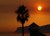Massive brush fires around San Diego make for a beautiful sunset in Coronado, California.
