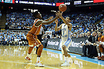18 December 2013: Texas' Isaiah Taylor (left) knocks the ball out of the hands of North Carolina's Marcus Paige (5). The University of North Carolina Tar Heels played the University of Texas Longhorns at the Dean E. Smith Center in Chapel Hill, North Carolina in a 2013-14 NCAA Division I Men's Basketball game. Texas won the game 86-83.