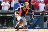 Miami Marlins catcher John Buck #14 takes a throw during a game against the Philadelphia Phillies at Citizens Bank Park on April 9, 2012 in Philadelphia, Pennsylvania.  Miami defeated Philadelphia 6-2.  (Mike Janes/Four Seam Images)