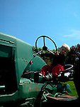 Child on antique Ford tractor