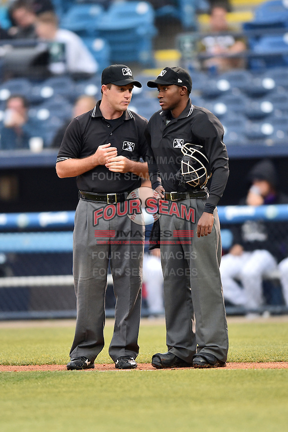 First base umpire and home plate umpire Tom West during a game between the Tourists and the Intimidators at McCormick Field on May 19, 2016 in Asheville, North Carolina. The Intimidators defeated the Tourists 10-7. (Tony Farlow/Four Seam Images)