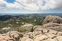Hikers explore the rock outcroppings of Harney Peak in the Black Elk Wilderness in South Dakota's Black Hills.