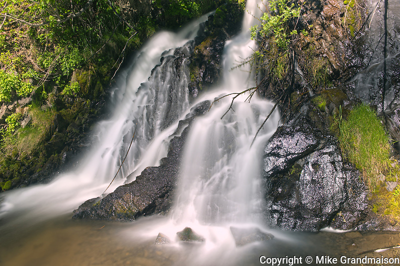Waterfall  along the road<br /> Along the Stewart Cassiar Highway<br /> British Columbia<br /> Canada
