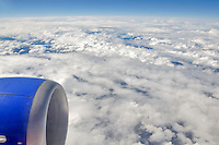 Clouds over California from 32,000 feet and boeing 737 jet engine.
