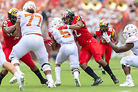 Landover, MD - September 1, 2018: Maryland Terrapins linebacker Isaiah Davis (22) tackles Texas Longhorns running back Tre Watson (5) for a loss during game between Maryland and No. 23 ranked Texas at FedEx Field in Landover, MD. The Terrapins upset the Longhorns in back to back season openers with a 34-29 win. (Photo by Phillip Peters/Media Images International)