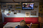 TV commentator John Motson on a television set in the tea room inside the ground before the Boxing Day derby match between Runcorn Town and visitors Runcorn Linnets at the Pavilions, Runcorn, in a top-of the table North West Counties League premier division match. Runcorn Linnets won 1-0 and overtook their neighbours at the top of the league in a game watched by 803 spectators. Runcorn Linnets were a successor club to Runcorn FC, one of England foremost non-League clubs of the 1970s and 1980s.