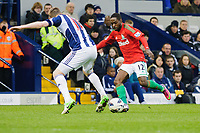 Saturday, 9 March 2013<br /> <br /> Pictured: Nathan Dyer of Swansea City kicks the ball around Chris Brunt of West Bromwich Albion<br /> <br /> Re: Barclays Premier League West Bromich Albion v Swansea City FC  at the Hawthorns, Birmingham, West Midlands