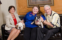 Left to right, Julie Burt, Champ, Courtney Brown, Mitsy (patient) and owner Rocky Sullivan.