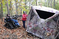 NWA Democrat-Gazette/FLIP PUTTHOFF <br /> Jackie helps Steve into his hunting blind in 2016. The buck Swope killed in September this year walked within five feet of the blind before Swope took it with a 30-yard crossbow shot.