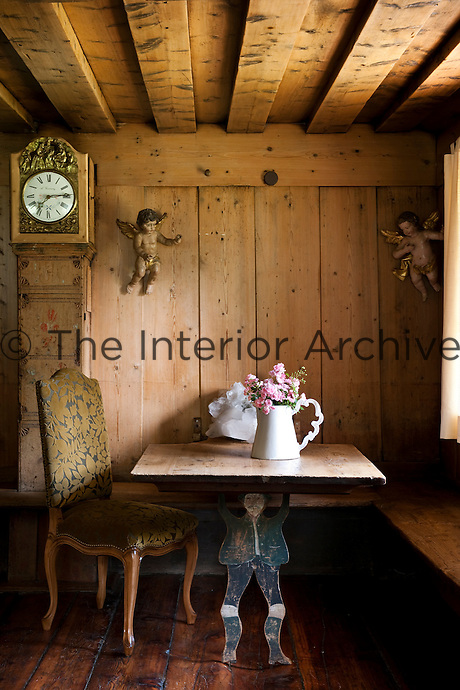 The original 'stube' is a wood-panelled living room furnished in a traditional fashion