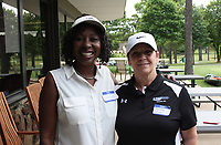 NWA Democrat-Gazette/CARIN SCHOPPMEYER Verlyn Gulley (left) and Theresa Lewis, Ronnie Brewer Foundation board members, welcome golfers to the benefit tournament June 22.