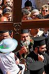 Israel, Jerusalem Old City, the Greek Orthodox Patriarch Irineos carrying the Cross at the Good Friday procession at the Via Dolorosa.  Easter 2005<br />