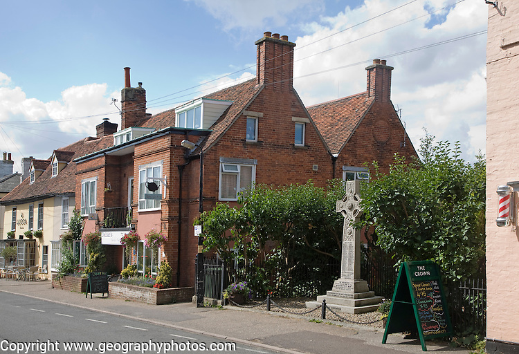 War memorial and historic buildings in High Street, Manningtree, Essex, England