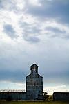 Corrugated grain elevator, building afternoon thunderstorm in Cody, Nebraska.
