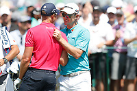 Justin Rose (ENG) shakes hands with Henrik Stenson (SWE) on the first tee during the third round of the 118th U.S. Open Championship at Shinnecock Hills Golf Club in Southampton, NY, USA. 16th June 2018.<br /> Picture: Golffile | Brian Spurlock<br /> <br /> <br /> All photo usage must carry mandatory copyright credit (&copy; Golffile | Brian Spurlock)