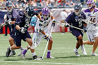 Conor Mackie  (#21) and Tyler Warner  (#5) battle Albany's Troy Reh (#10) for a ground ball after a faceoff as Yale defeats UAlbany 20-11 in the NCAAA semifinal game at Gillette Stadium, May 26.