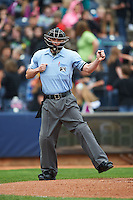 Umpire Blake Felix makes a call during a game between the New Britain Rock Cats and Akron RubberDucks on May 21, 2015 at Canal Park in Akron, Ohio.  Akron defeated New Britain 4-2.  (Mike Janes/Four Seam Images)