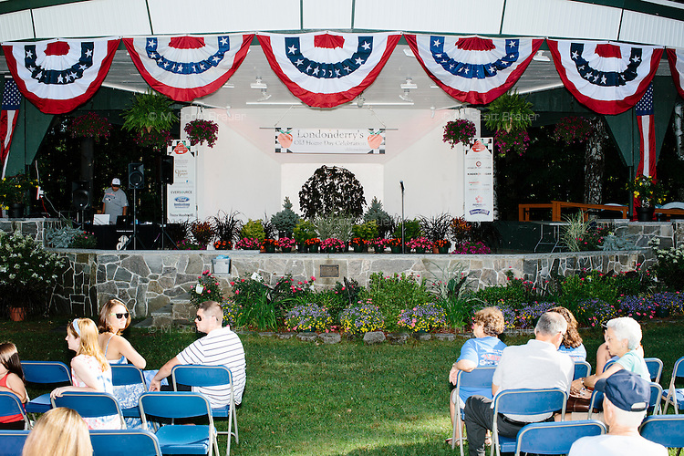 People wait for performances to begin at Londonderry Old Home Day in Londonderry, New Hampshire. Republican presidential candidate Dr. Ben Carson later showed up at the event to meet New Hampshire voters.