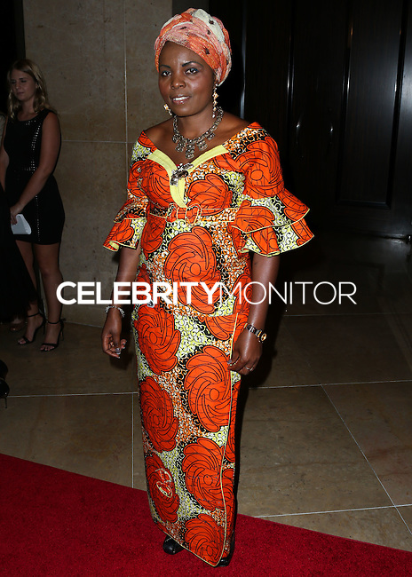 BEVERLY HILLS, CA, USA - OCTOBER 28: Solange Lusiku Nsimire arrives at the 25th Annual Courage in Journalism Awards held at the Beverly Hilton Hotel on October 28, 2014 in Beverly Hills, California, United States. (Photo by Xavier Collin/Celebrity Monitor)