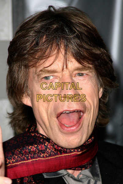 "MICK JAGGER .""Shutter Island"" special screening held at the Ziegfeld Theatre, New York City, NY, USA, 17th February 2010..arrivals portrait headshot open mouth funny red scarf  print patterned pattern.CAP/ADM/PZ.©Paul Zimmerman/Admedia/Capital Pictures"