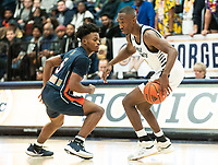 WASHINGTON, DC - NOVEMBER 16: Shawn Walker Jr. #1 of George Washington dribbles up to Sherwyn Devonish #5 of Morgan State during a game between Morgan State University and George Washington University at The Smith Center on November 16, 2019 in Washington, DC.
