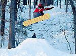 Thomas Wood, 21,  of Manchester, goes off a large snow jump on his snowboard as his friend Jacob Abramo, rear, looks on, Saturday, January 6, 2018, at Center Springs Park in Manchester. (Jim Michaud / Journal Inquirer)