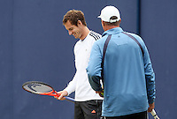 11.06.13 London, England. Andy Murray shares a joke with coach Ivan Lendl during practice at the The Aegon Championships from the The Queen's Club in West Kensington.