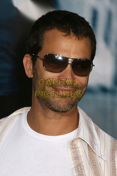 "JONATHAN SCHAECH.""The Bourne Ultimatum"" Los Angeles Premiere at the Arclight Theatre, Hollywood, California, USA..July 25th, 2007.headshot portrait sunglasses shades stubble facial hair .CAP/ADM/BP.©Byron Purvis/AdMedia/Capital Pictures"