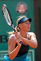 Maria Sharapova (RUS) against Anastasiya Yakimova (BLR) in the frst round of the Women's Singles. Sharapova beat Yakimova 3-6 6-1 6-2 ..Tennis - French Open - Day 2 - Mon 25th May 2009 - Roland Garros - Paris - France.Frey Images, Barry House, 20-22 Worple Road, London, SW19 4DH.Tel - +44 20 8947 0100.Cell - +44 7843 383 012