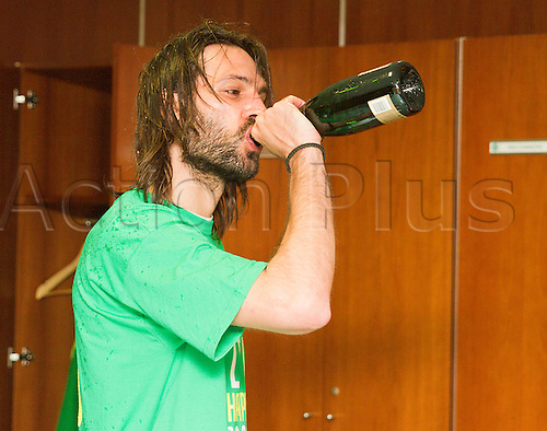21.04.2013 Glasgow, Scotland. Georgios Samaras enjoys the champagne after the Scottish Premier League game between Celtic and Inverness Caledonian Thistle from Celtic Park.