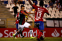 SANTIAGO DE CHILE - CHILE: 06-02-2019: Roberto Gimenez de Club Deportivo Palestino (CHL) disputa el balón con Elvis Perlaza de Deportivo Independiente Medellín (COL), durante partido de la Segunda fase, llave 4, entre Club Deportivo Palestino (CHL) y Deportivo Independiente Medellín (COL), por la Copa Conmebol Libertadores 2019 en el estadio San Carlos de Apoquindio, de la ciudad de Santiago de Chile. / Roberto Gimenez of Club Deportivo Palestino (CHL), vies for the ball with Elvis Perlaza of Deportivo Independiente Medellin (COL), during a match between Club Deportivo Palestino (CHL) and Deportivo Independiente Medellin of the second phase, key 4, for Copa Conmebol Libertadores 2019 at the San Carlos de Apoquindio, Stadium, in the city of Santiago de Chile. Photos: VizzorImage / Andrés Piña / Cont. / Photosport