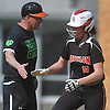 Emily Bell #18, Babylon first baseman, gets congratulated by head coach Rick Punzone after connecting for a three-run home run in the bottom of the first inning of a Suffolk League VII varsity softball game against Shoreham-Wading River at Babylon Elementary School on Tuesday, May 1, 2018. Babylon won 13-1 for Punzone's 300th career coaching victory in the sport.