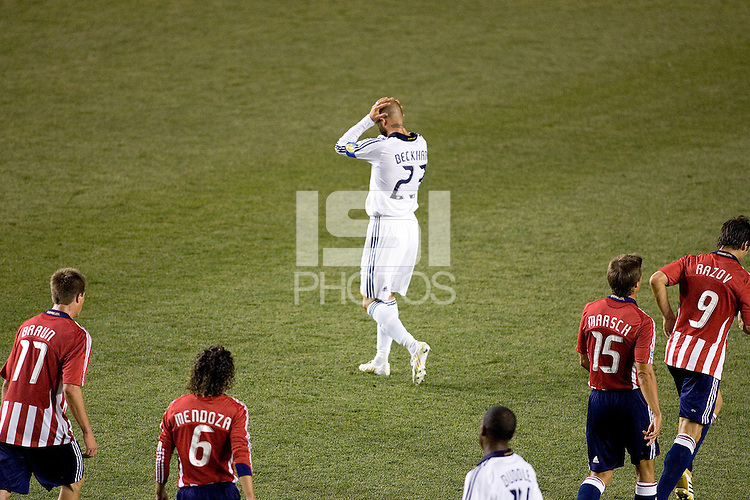 LA Galaxy midfielder David Beckham (23) reacts after narrowly missing a goal during the Super Clasico MLS match. The LA Galaxy defeated Chivas USA 5-2 during the SuperClasico at the Home Depot Center Stadium, in Carson, California, Saturday, April 26, 2008.