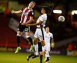 Caolan Lavery of Sheffield Utd jumps with Kory Roberts of Walsall during the Carabao Cup First Round match at Bramall Lane Stadium, Sheffield. Picture date: August 9th 2017. Pic credit should read: Simon Bellis/Sportimage