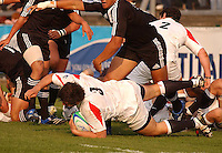 England tight-head Alex Corbisiero gathers up this loose ball during the Division A U19 World Chanpionship match against New Zealand at Ravenhill, Belfast.