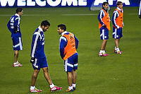 Argentina soccer players Sergio Aguero (C ) and Ezequiel Garay talk while they attend a practice at Red Bull stadium ahead of his friendly match against Ecuador in New Jersey, Nov 13, 2013. VIEWpress/Eduardo Munoz Alvarez