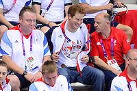 PICTURE BY ALEX BROADWAY /SWPIX.COM - 2012 London Paralympic Games - Day Six - Swimming, Aquatic Centre, Olympic Park, London, England - 04/09/12 - NPD John Atkinson, Prince Harry and Tim Reddish watch from the stands.