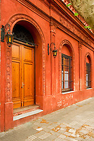 Uruguay, Colonia de Sacramento, Arched doorway along cobbled side street