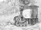 Mixed freight with oil tanks pulled by #497 and pushed by #488 according to Bender.<br />   Taken by Bender, Henry E. Jr. - 6/23/1963