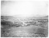 Panoramic stype view showing much of Cimarron.  Flour mill is prominent right center.<br /> Cimarron, NM  1877