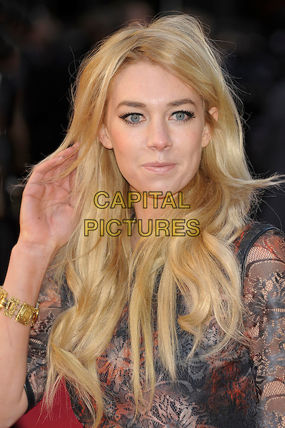 Vanessa Kirby.The Olivier Awards 2012, Royal Opera House, Covent Garden, London, England..April 15th, 2012.headshot portrait hand arm print black sheer red blue  .CAP/PL.©Phil Loftus/Capital Pictures.