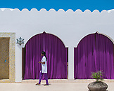 ZANZIBAR, Nungwi Beach, a Spa Personnel wearing white and purple uniform outside the treatment area
