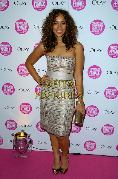 LEONA LEWIS.Cosmopolitan Fun Fearless Female Awards 2007 held at Cirque, Leicester Square, London, England. .November 6th 2007 .full length strapless silver dress gold clutch bag hand on hip .CAP/CAN.©Can Nguyen/Capital Pictures