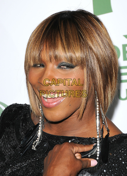 SERENA WILLIAMS .The 7th Annual Global Green Pre-Oscar Party held at Avalon in Hollywood, California, USA. .March 3rd, 2010              .headshot portrait black metallic fringe bangs dangling earrings sequins silver sequined blue eyeliner eyeshadow make-up smiling beauty .CAP/RKE/DVS.©DVS/RockinExposures/Capital Pictures.