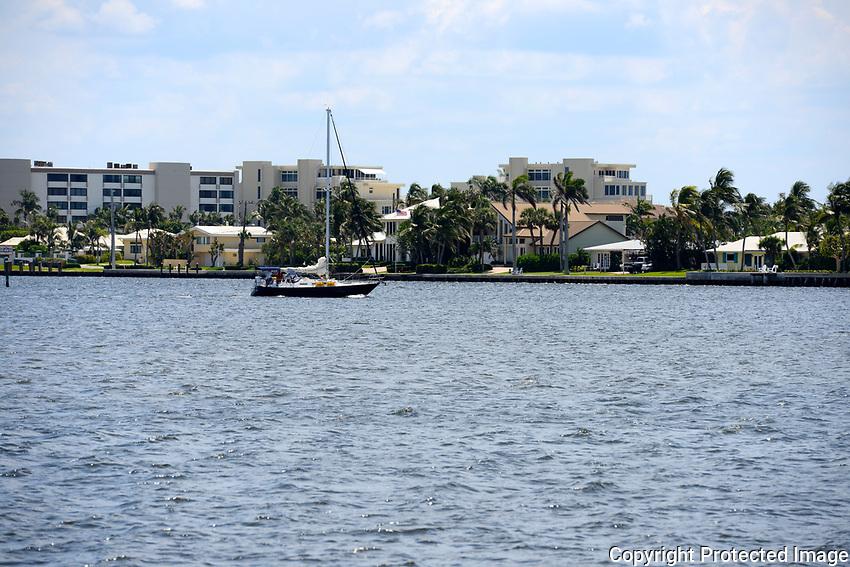Beautiful sailboat under power cruising the intracoastal waterway near Boynton Beach, Florida.