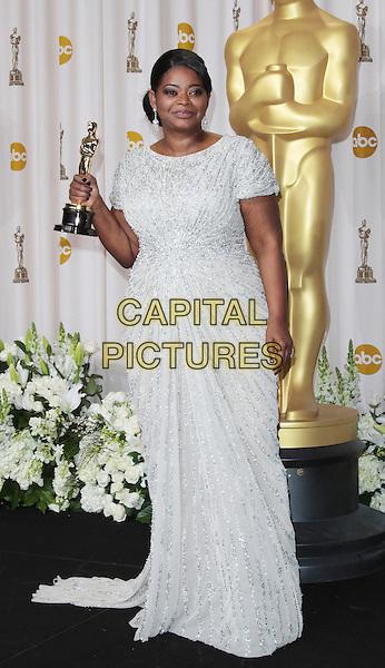 Octavia Spencer.84th Annual Academy Awards held at the Hollywood & Highland Center, Hollywood, California, USA..February 26th, 2012.oscars full length award trophy winner white dress beads beaded silver .CAP/ADM/SLP/JO.©James Orken/ SLP/AdMedia/Capital Pictures.
